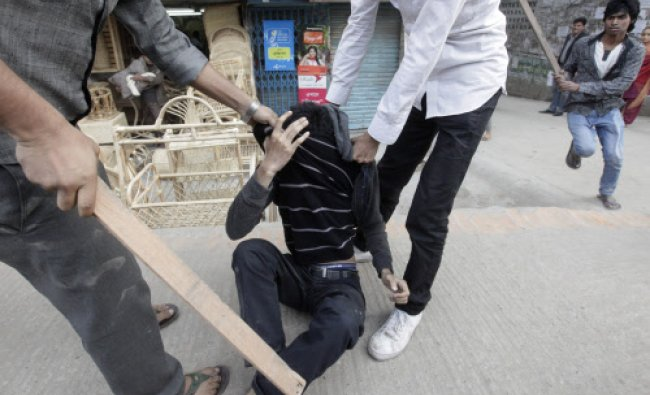 Pro-government activists attack a man they believe to be a Jammat-e-Islami activist...