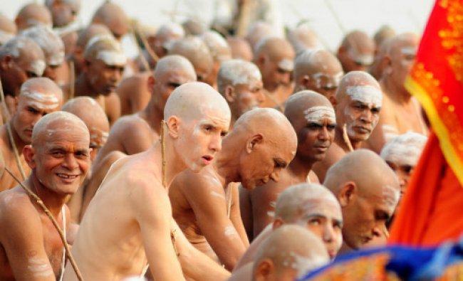 Newly initiated \'Naga Sadhus\' perform rituals on the bank of the Ganga River...