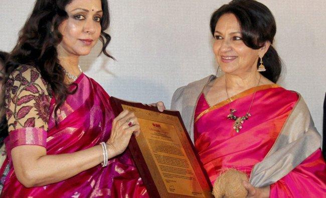 Veteran actor Hema Malini presenting Lifetime Achievement award to actress Sharmila Tagore...