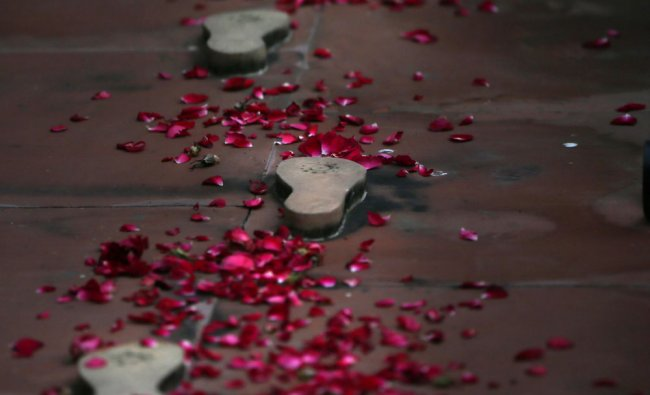 Flowers decorate the footprints that mark the last steps of Mahatma Gandhi, on his death...