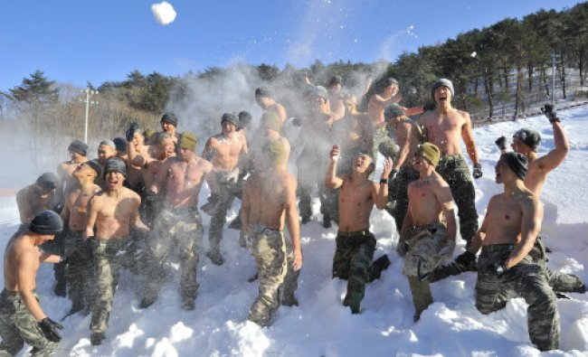 South Korea and US Marines hurl snow during a joint winter drill