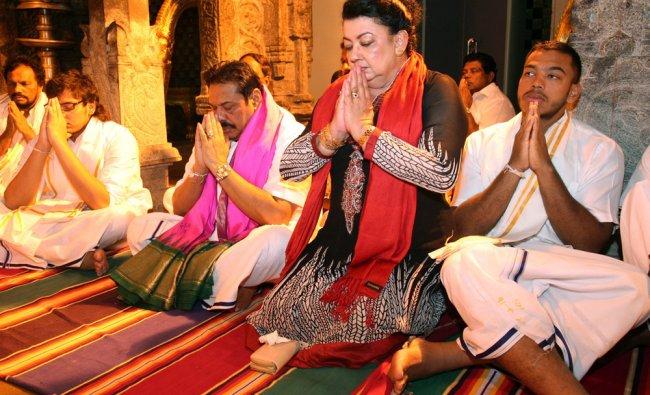 Sri Lankan President Mahinda Rajapaksa, center, along with his wife Shiranthi Rajapaksa offer....