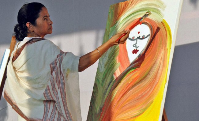 West Bengal Chief Minister Mamata Banerjee paints on a canvas during \'Mati Utsav\'(Soil Festival)...