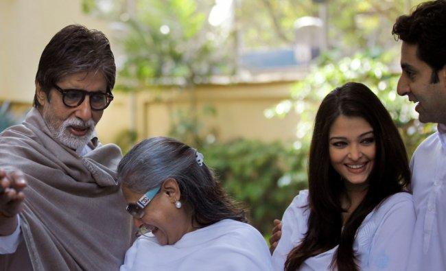 Bollywood star Amitabh Bachchan, left, along with his wife Jaya Bachchan, second left....