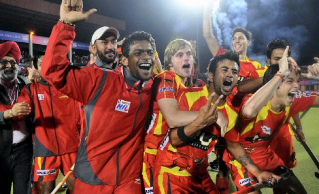 Players of Ranchi Rhinos celebrate their victory after winning the final match of Hockey India...