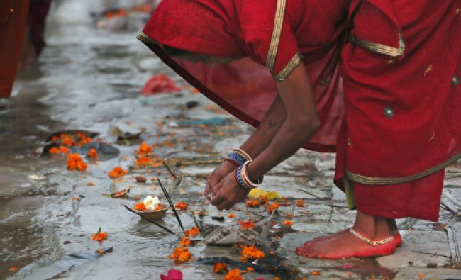 A Hindu woman devotee performs a ritual at \'Sangam\'