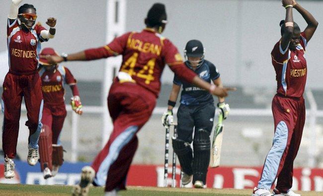 West Indies players celebrate the dismissal of New Zealand batswoman Frances Mackay...