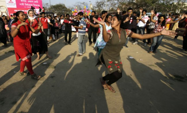 Women participate in an event to support the \'One Billion Rising\' global campaign...