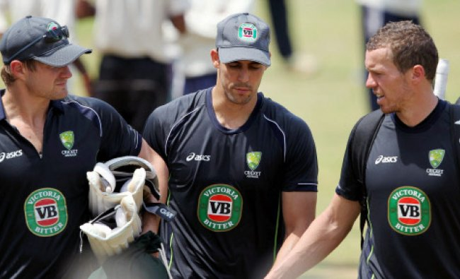Australian cricketers Shane Watson, Mitchell Jhonson and Peter Siddle during a practice session...