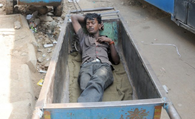 A laborer takes a nap as no work for him during 48 hour general \'bundh\' at KR Market...