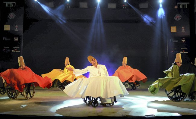 Differently-abled artists of Ability Unlimited Foundation performing \'Sufi on wheels\'...