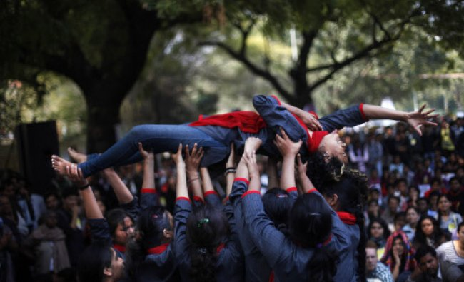 Volunteers perform a skit as women\'s groups gather near Indian parliament to protest...
