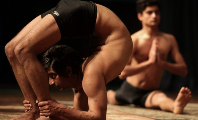 Indian yoga participants perform exercises during the inaugural session of World Yoga Conference...