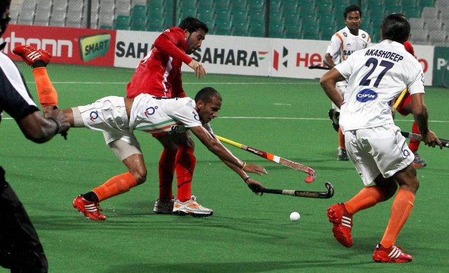 Indian and Oman players vie for the ball during the FIH Hockey World League Round2-Men