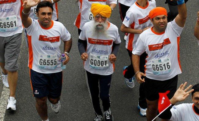 Centenarian marathon runner Fauja Singh, 101, center, originally from Beas Pind, in Jalandhar, India