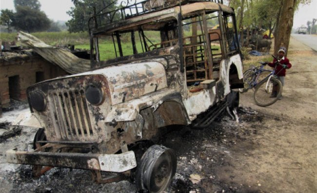 A jeep set on fire by the armed cadres of the Peoples\' Liberation Front of India...