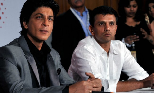 Bollywood film actor Shah Rukh Khan (L) and former Indian cricketer Rahul Dravid attend...