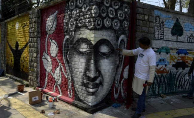 Indian artists create wall paintings during the \'Design The Change\' wall art event in New Delhi...