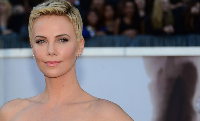 Actress Charlize Theron arrives on the red carpet for the 85th Annual Academy Awards on February 24,