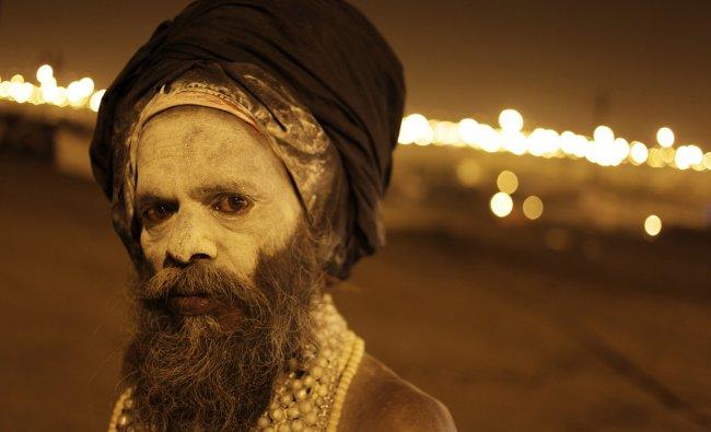 A Hindu holy man reacts to camera at Sangam...