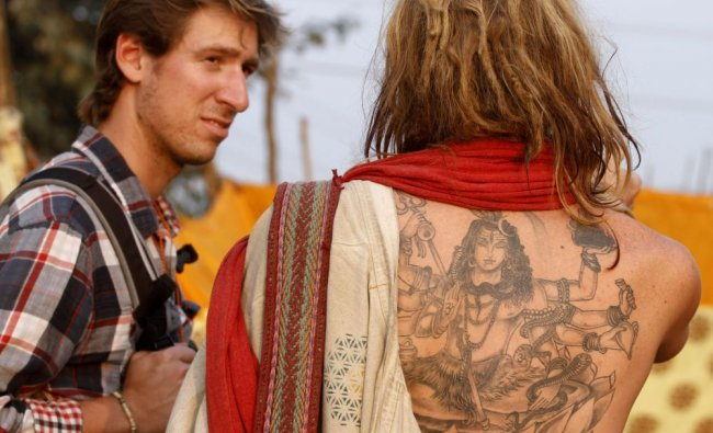 A foreign devotee bearing a tattoo of Hindu Lord Shiva on his back is seen in Sangam...
