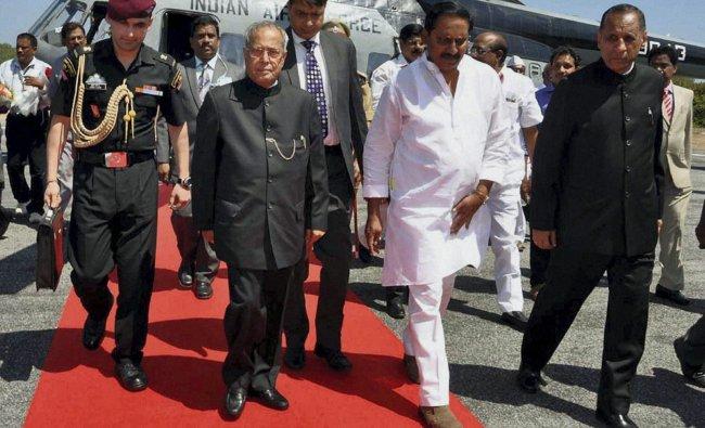 Pranab Mukherjee walks with AP Governor E.S.L. Narsimham and CM N. Kiran Kumar Reddy...