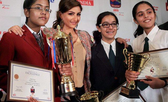 Actress Soha Ali Khan with awardees at the \'Spell bee\' awards function in Mumbai ...