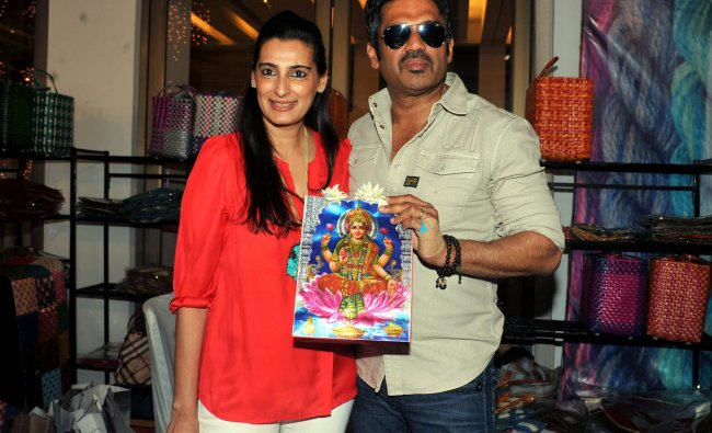 Suniel Shetty poses for a photo with his wife Mana Shetty (L), who organised an exhibition...