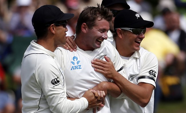 New Zealand\'s Martin celebrates with teammates after dismissing England\'s Prior during...