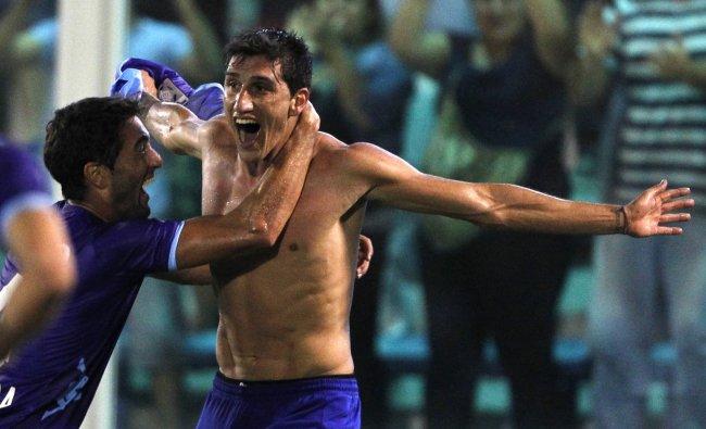Gabriel Penalba of Argentina\'s Tigre celebrates with teammate Diego Ferreira during their Copa...