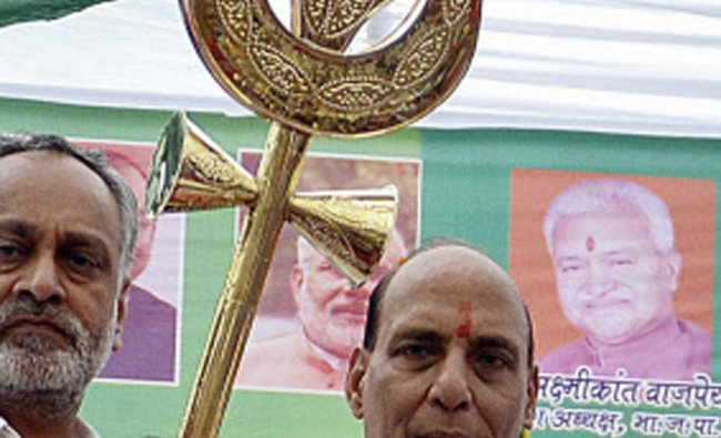 BJP President Raj Nath Singh holds a trident presented to him at a function in Ghaziabad...