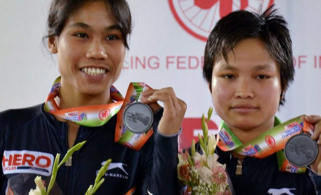 India\'s Deborah and Manorama showing their bronze medal in final of women\'s Team Sprint event...