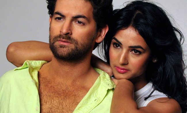 Bollywood actors Neil Nitin Mukesh and Sonal Chauhan pose during a photo shoot for the film 3G...