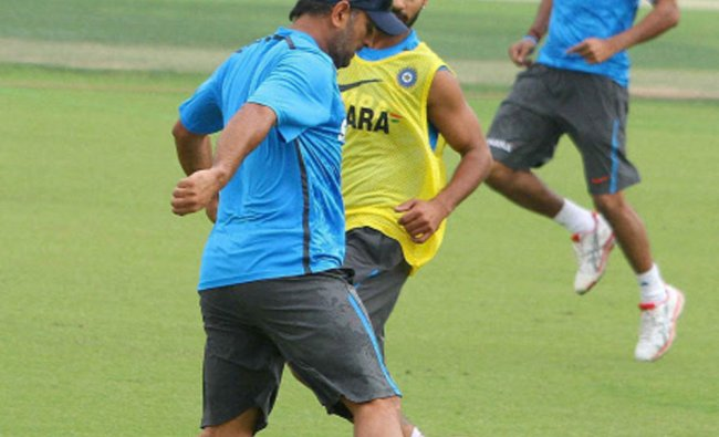Indian cricket team players play football during a practice session in Mohali...