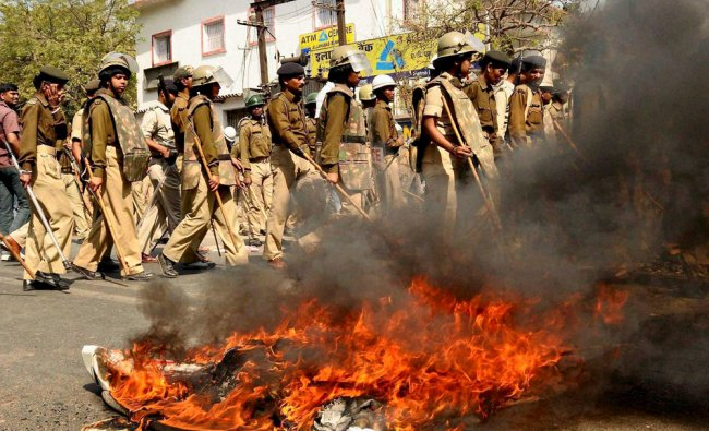 Burning tyre after angry students agitated against the murder of a student in Patna ...