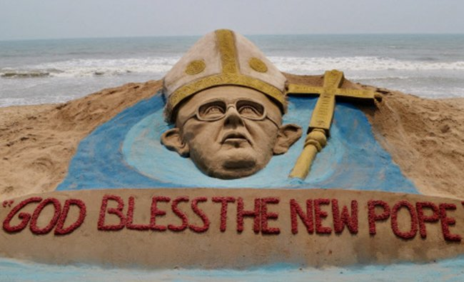 International sand artist Sudarsan Pattnaik creates a sand sculpture of new Pope Francis...