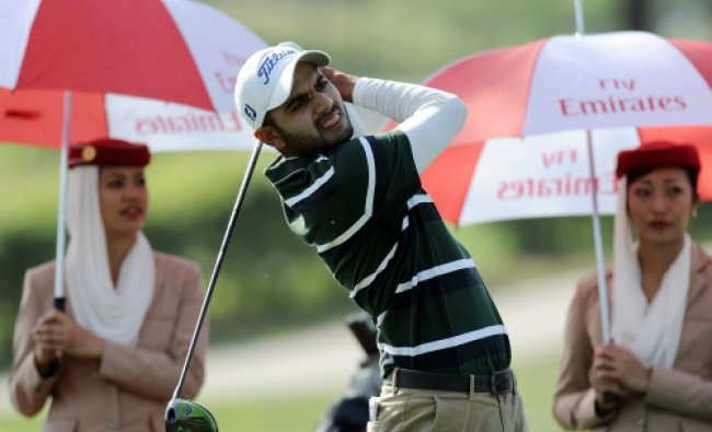 Abhijit Singh Chadha of India tees off on the eighteenth hole during the Avantha Masters golf...