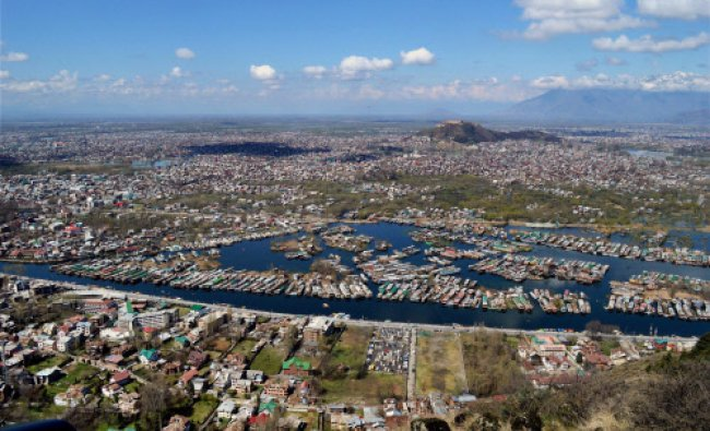 An aerial view of the Srinagar city during the second day of the curfew imposed following...
