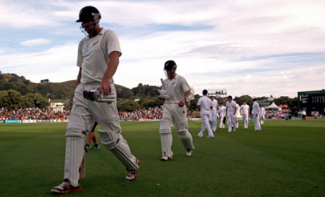 New Zealand\'s Peter Fulton (L) walks off the ground with teammate Kane Williamson at...