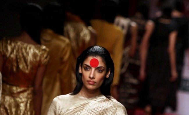 A Model display creations of designer Abraham & Thakore at the Wills Lifestyle India Fashion Week...