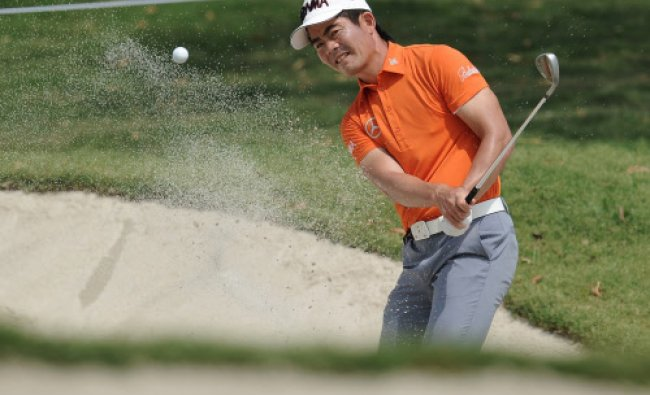Liang Wenchong of China hits the ball out of bunker on the second hole during the Avantha Masters...