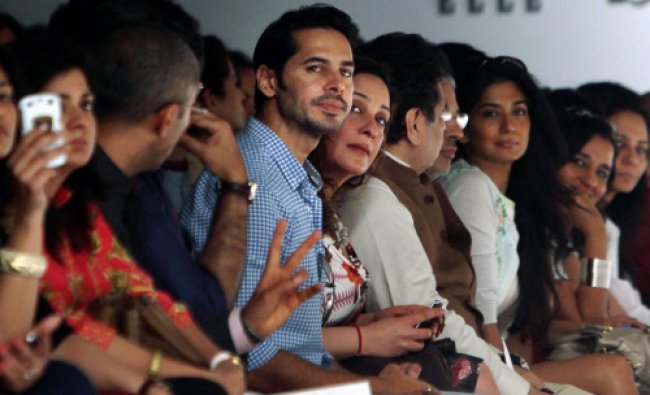 Bollywood actor Dino Morea looks on during designer Rina Dhaka\'s show at the Wills Lifestyle...