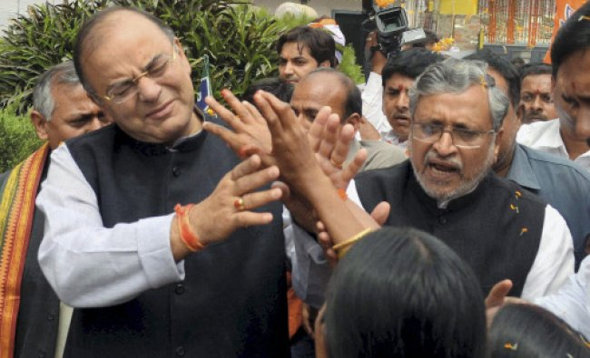 BJP leaders Arun Jaitley and Sushil Kumar Modi during the party\'s working committee meeting...