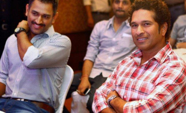 Cricketers Sachin Tendulkar and M S Dhoni at the book launch function on Tendulkar...