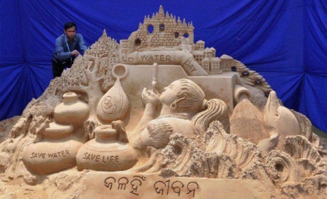 Sand artist Subal Maharana gives final touches to his sand sculpture ahead of World Water Day...
