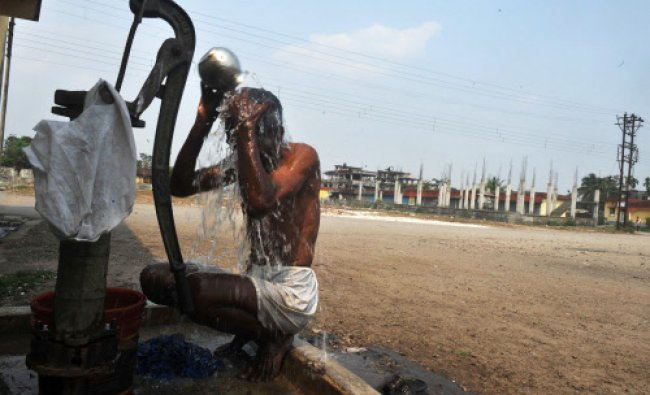 A man bathes in Siliguri on March 21, 2013. World Water Day calls for international attention...