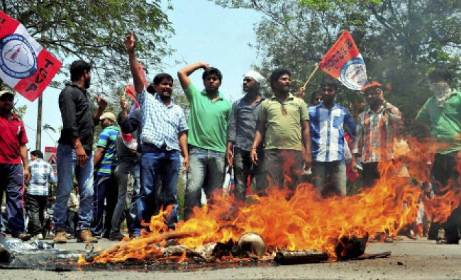 Students hold a protest on the campus of Osmania University after they were not permitted to take...