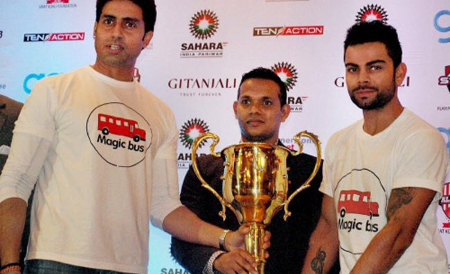 Actor Abhishek Bachchan and cricketer Virat Kohli unveils the trophy for a charity football...
