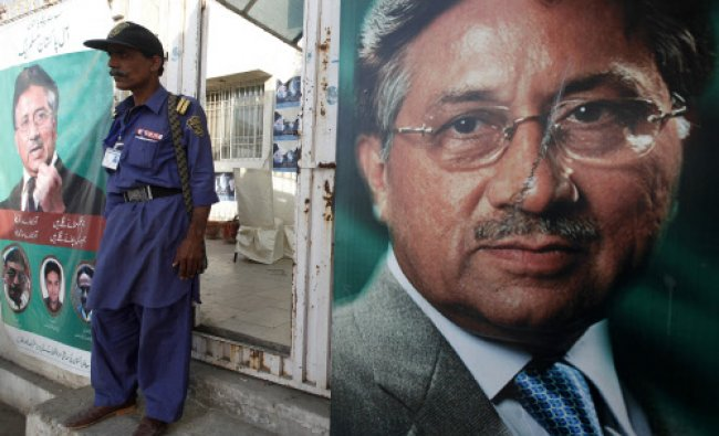 A security man stands guard at the entrance of former president Pervez Musharraf\'s campaign office..