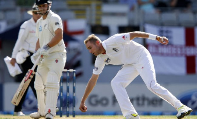 Stuart Broad fields off his own bowling watched by Hamish Rutherford of New Zealand during....